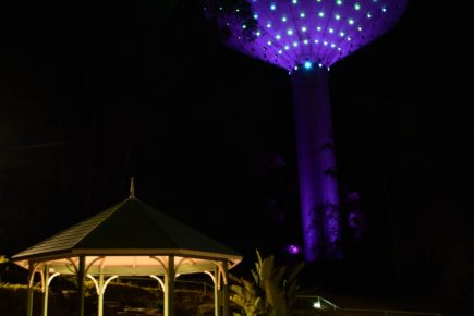 A photo of the Wineglass Water Tower with lights on.